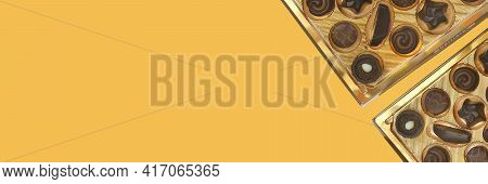 Chocolate Truffles. Sweets And Chocolate Banner. Chocolate Candy Box On Brown Background.assortment