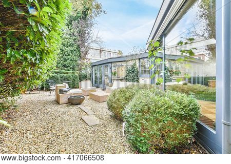Beautiful Backyard Terrace Full Of Furniture And Decorative Plants