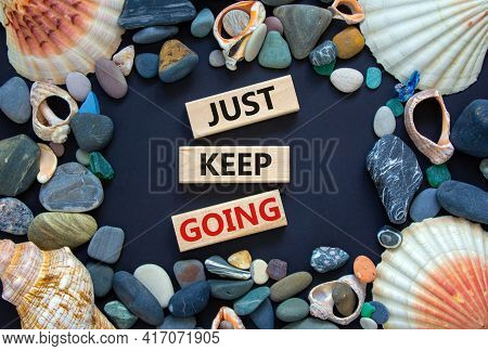 Just Keep Going Symbol. Wooden Blocks With Words 'just Keep Going'. Beautiful Black Background, Seas