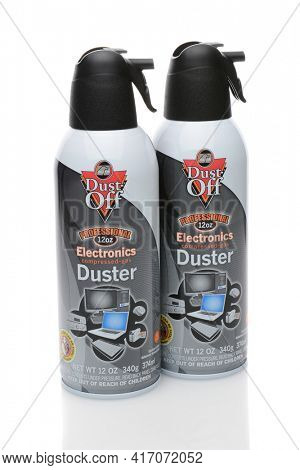IRVINE, CA - DECEMBER 29, 2014: Two cans of Dust-Off cleaner. From Falcon it contains difluoroethane and is used to remove particulates and dust from computers and electronic equipment.