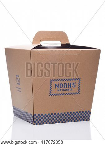 IRVINE, CALIFORNIA - 8 JUNE 2020: A Noahs NY Bagels cardboard carry out container.
