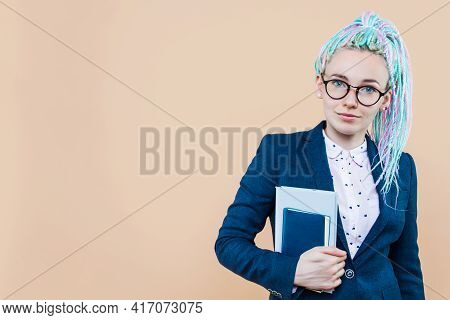 Positive Modern Business Lady With Colored Dreadlocks Is Smiling. Young Woman, Leader, Trainer, Spea