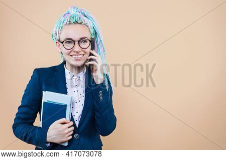 Business Lady With Colored Dreadlocks Is Talking On Phone, Holding Planner Book. Woman Girl In Suit