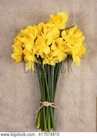 A Bouquet Of Yellow Daffodils On A Linen Napkin. Bright, Fresh Spring Daffodils Are Sold At The Flow