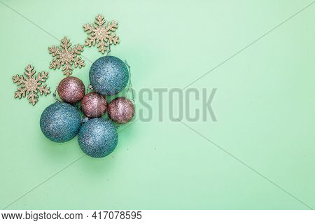 December Season Composition, Top View With Copy Space On Green Background. Christmas Composition Wit