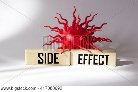 Side Effects On Wooden Blocks And White Background. Pharmaceutical Medical Preparations Concept.