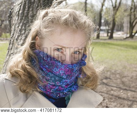 Young Pretty Blonde Girl Enjoing Spring Nature In Park, Lifestyle People Concept Close Up