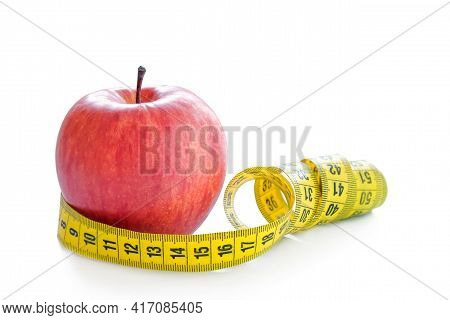 Red Apple With Measuring Tape Isolated On White Background. Healthy Lifestyle, Diet Concept. Close-u