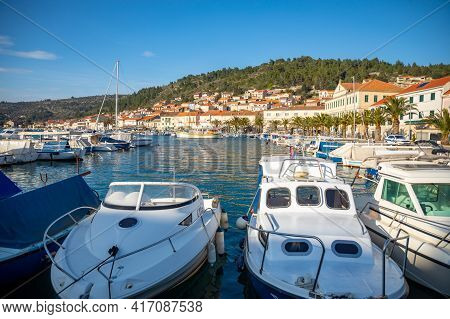 Vela Luka, Croatia - 29.03.2021: Small Boats In The Port Of Vela Luka On Old Town Background, Korcul