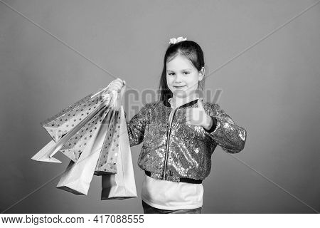 Girl With Shopping Bags Violet Background. Shopping And Purchase. Black Friday. Sale Discount. Shopp