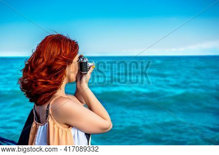 Red Haired Woman In Summer Dress Travel Photographer, Taking Pictures Of Sea. Rare Photographic Came