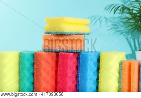 Colored Sponges For Washing Dishes And Cleaning With Foam On A Light Background. The Concept Of Clea