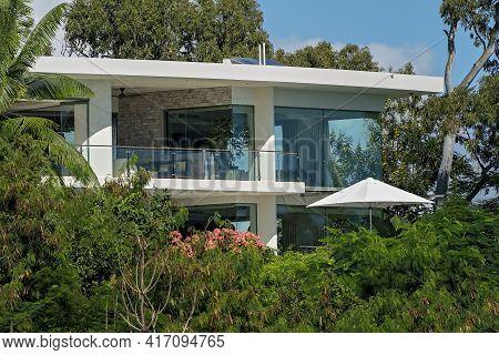 Airlie Beach, Queensland, Australia - April 2021: Modern Designed Home On A Bushy Hillside