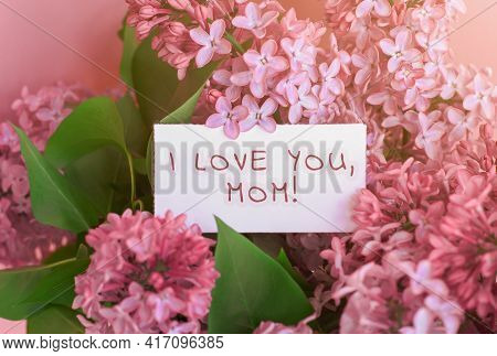 Beautiful Spring Bouquet Of Lilac Flowers And Gift Cardboard White Card With The Inscription I Love