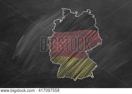 Country Map And Flag Of Germany Drawing With Chalk On A Blackboard. One Of A Large Series Of Maps An