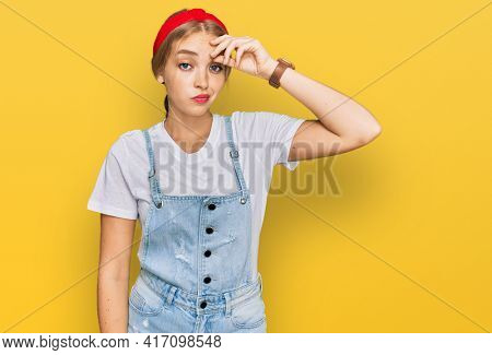 Young caucasian girl wearing casual clothes worried and stressed about a problem with hand on forehead, nervous and anxious for crisis