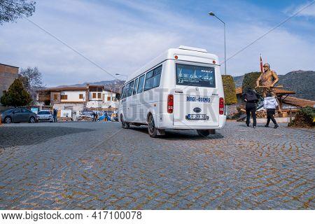 Birgi, Izmir, Turkey - 03.09.2021: A Minibus For Birgi-odemis Destination In Birgi Village And Passe