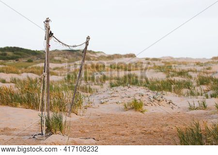 Neglected Beach Volleyball Net With Coastal Dunes, Mossel Bay, South Africa