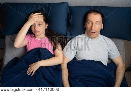 Sleep Apnea Snoring Disturbance. Angry Woman And Snoring Man