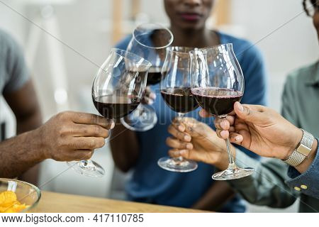 African Friends Red Wine Toast Cheers During Celebration