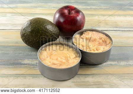 Avocado, Apple And Two Cans Of Canned Albacore Tuna Soaked In Water Ingredients For Preparing Tuna S