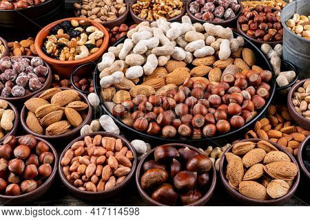 Set Of Pecan, Pistachios, Almond, Peanut, Cashew, Pine Nuts And Assorted Nuts And Dried Fruits In A