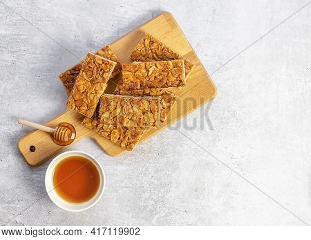 Almond Florentines Or Bee Sting, Thin Shortbread Covered Cookies With Honey. Light Concrete Backgrou