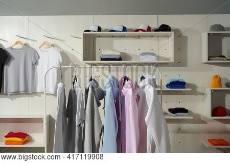 Clothes At Custom Clothing Printing Company. Set Of Blank Pastel Cotton White, Gray, Blue And Pink S