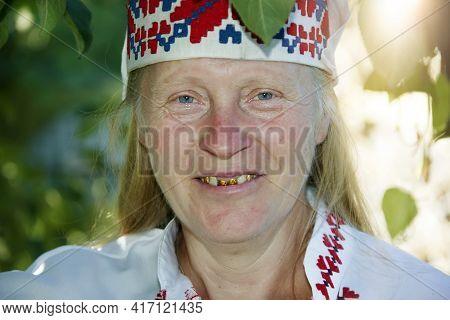 Portrait Of A Smiling Slavic Elderly Woman In A National Headdress With A Smile. Ukrainian Or Belaru