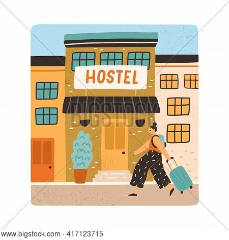 Tourist With Backpack And Suitcase Going To Hostel Entry. Hotel Building For Night Accommodation. Co