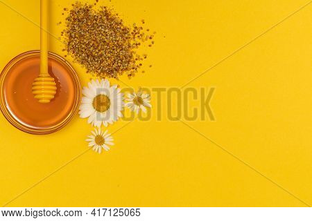 A Yellow Spoon Of Honey Dipped In A Jar Of Honey And Bee Bread Scattered On A Yellow Background Deco