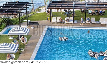 Airlie Beach, Queensland, Australia - April 2021: Guests Swimming And Relaxing In And Around Resort