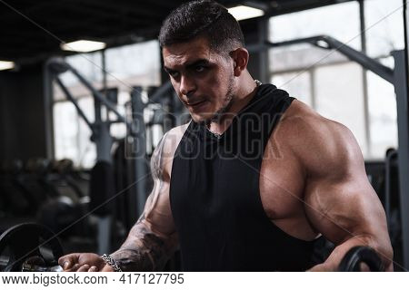 Cropped Shot Of A Ripped Weightlifter Doing Biceps Curls With Dumbbell