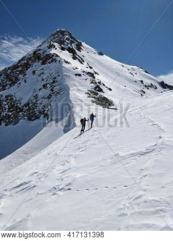 Ski Tour On The Fanellhorn Above Vals Grisons. Ascent Over The West Flank. Beautiful Snowy Mountains