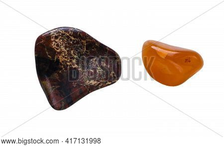 Two Semi-precious Stones Isolated On A White Background. Colorful Brown Jasper And Orange Carnelian.