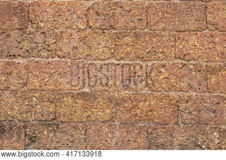 Blur Of Red Laterite Brick Wall Porous And Fine-grained Background Pattern , Seamless Blackground Pa