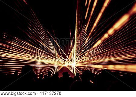 Golden Laser Show Nightlife Club Stage With Party People Crowd. Luxury Entertainment With Audience S