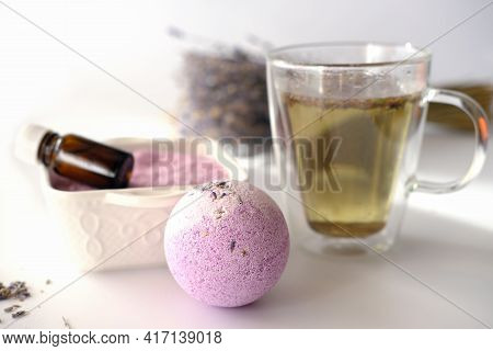 Calming Lavender Bath Salt And Bath Bomb For Relaxing Home Spa. Tea With Lavender Flowers. Essential