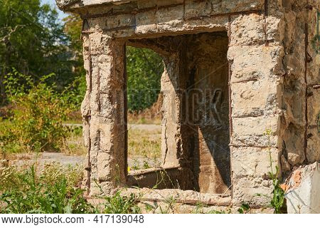 Ruins Of An Old Building In The Town. Abandoned Old School Yard. Windows Of A Dilapidated Utility Ro