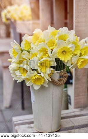 Fresh Spring Bright Yellow Daffodil Flowers In A Metal Pot. Large Bouquets In Tin Vases.