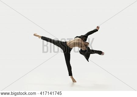 Man In Casual Style Clothes Jumping And Dancing Isolated On White Background. Art, Motion, Action, F