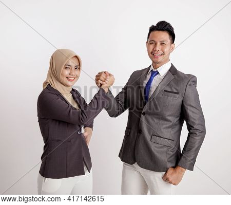 Two Young Couples Business Very Excited Working Looking At The Camera Holding Hand Together