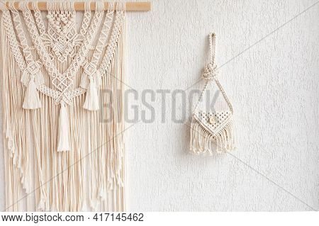 Handmade White Macrame Bag And Wall Hanging On The White Wall, Eco Friendly. Hobby Knitting Handmade