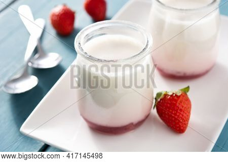 Panna Cotta Dessert With Strawberry On Blue Wooden Table