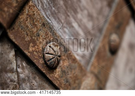 Fragment Of The Old Iron Door. Old Medieval Metal Gate Background.