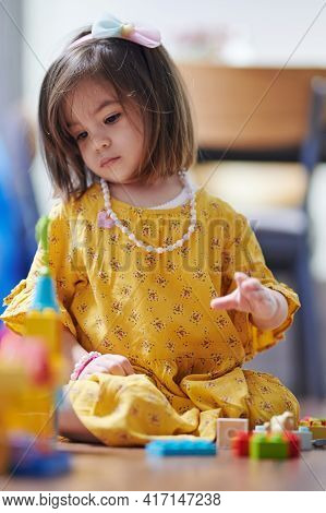 Little Girl Play With Blocks In Room. Small Kids Learning Theme
