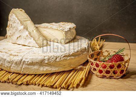 Cheese Camambert With Raspberry Basket. Rustic Set On Black Backdrop. Healthy Fresh Nutrition. Healt