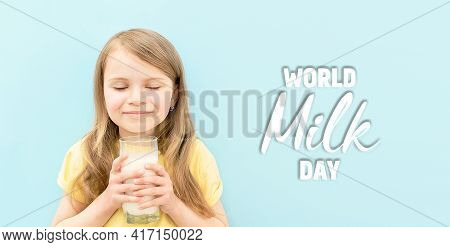 World Milk Day. Cute Little Girl With Her Eyes Closed Drinks White Milk From Transparent Glass On Bl