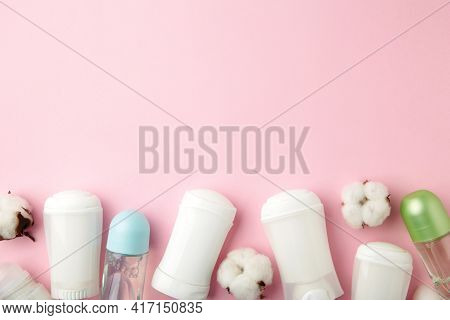 Different Deodorants With Cotton On Pink Background With Copy Space. Top View.
