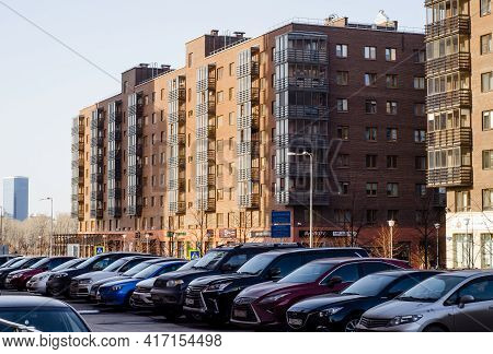 Modern Multi-storey Residential Buildings Built Of Brick, With Car Parking In  Courtyard. Russia. Kr